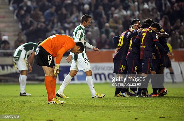 Cordoba's goalkeeper Mikel Saizar reacts as Barcelona's players celebrate their second goal during the Spanish Copa del Rey football match Cordoba FC...