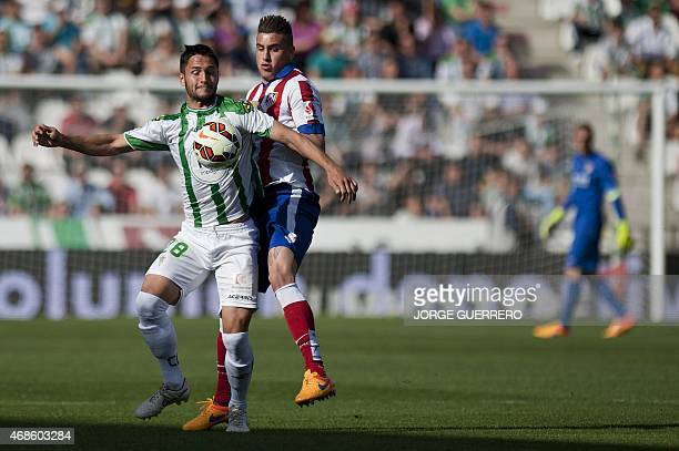 Cordoba's Romanian forward Florin Andone vies with Atletico Madrid's Uruguayan defender Jose Maria Gimenez during the Spanish league football match...