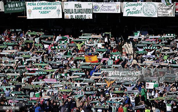 Cordoba's supporters hold up scarves and banners during the Spanish league football match Cordoba CF vs Real Madrid CF at the Nuevo Arcangel stadium...