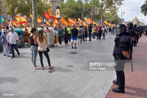 A cordon of security of the Catalan police seen separating an antifascist counterdemonstration during the demonstration in favor of the unity of...