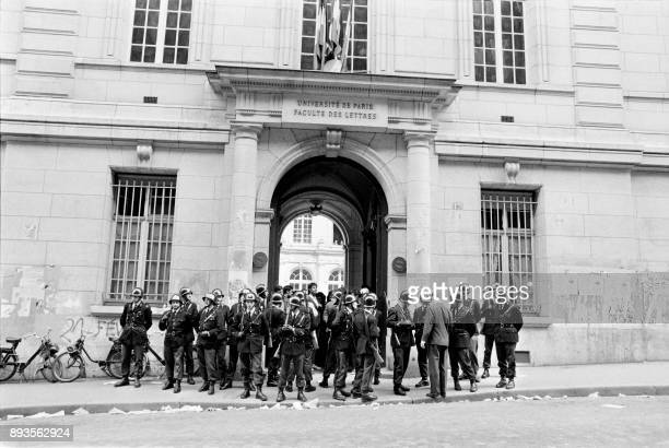A cordon police stands guard in front of the university La Sorbonne during a student protest on May 3 during the MayJune 1968 events in France / AFP...