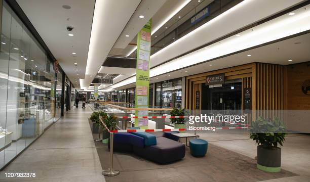 Cordon surrounds a seating area in a near empty shopping mall in Munich, Germany, on Saturday, March 21, 2020. Germany may impose a nationwide...