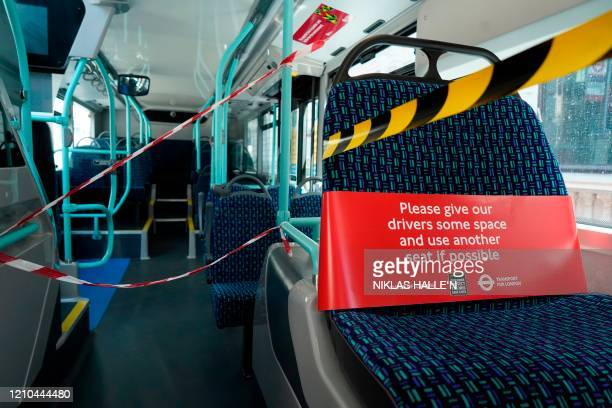 A cordon surrounds the front of a London bus on April 20 2020 in London during the novel coronavirus Covid19 pandemic London's transport authorities...