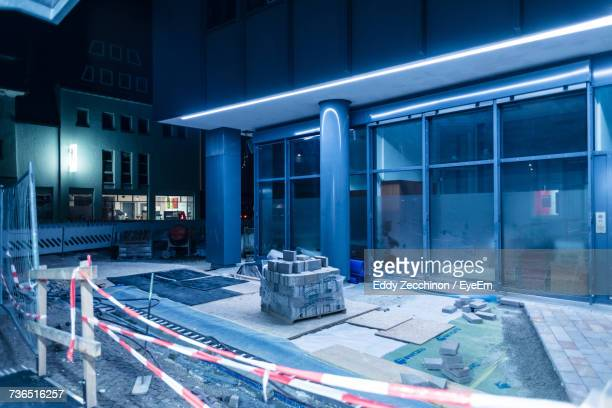 Cordon Tape By Incomplete Building In City At Night