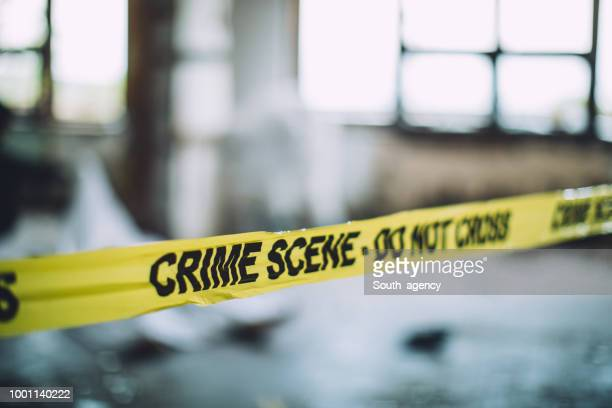 cordon tape on a crime scene - violence stock photos and pictures