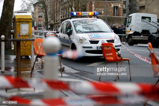 Cordons are seen near a municipal police car at the site of a shooting on the morning of January 8 2015 in Montrouge south of Paris A policewoman and...