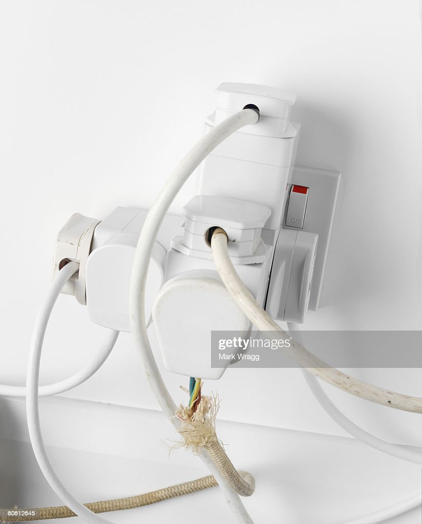 Cords in overused outlet : Stock Photo