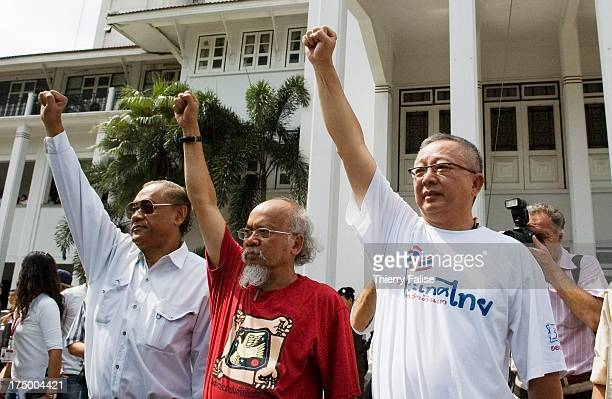 Core leaders of the People's Alliance for Democracy Piphop Thongchai Somsak Kosaisuk and Sondhi Limthongkul wave to supporters at the Thai police...