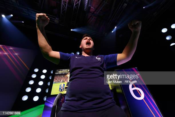 Corentin 'MAESTRO' Thullier of France celebrates as his teammate Lucas 'DaXe' Cuillerier of France scored in the X-box leg of the Final between...