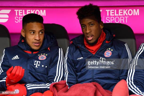 Corentin Tolisso and Kingsley Coman of Bayern Muenchen sit on the bench prior to the Bundesliga match between FC Bayern Muenchen and SV Werder Bremen...