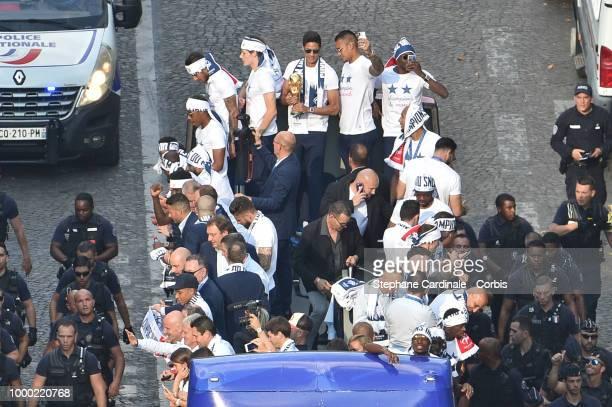 Corentin Tolisso Benjamin Pavard Raphael Varane holding the trophy Alphonse Areola Blaise Matuidi and Olivier Giroud celebrate with teammates on the...