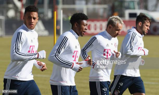 Corentin Tolisso David Alaba Rafinha and Juan Bernat of FC Bayern Muenchen warm up during a training session at the club's Saebener Strasse training...
