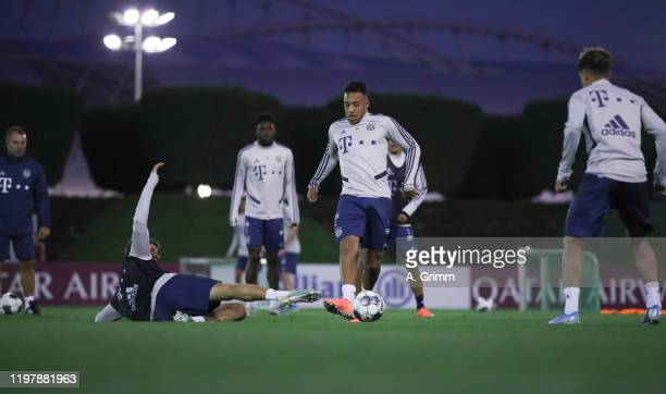 Corentin Tolisso is challenged by Thomas Mueller during a training session on day three of the FC Bayern Muenchen winter training camp at Aspire...