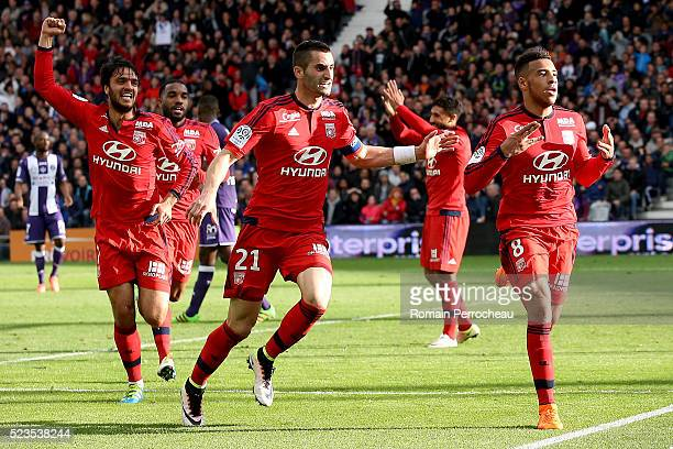 Corentin Tolisso Maxime Gonalons and Clement Grenier of Lyon react after scoring during the French Ligue 1 match between Toulouse and Lyon at Stadium...