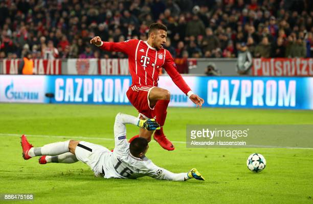 Corentin Tolisso of Bayern Muenchen attempts to get past Alphonse Areola of PSG during the UEFA Champions League group B match between Bayern...