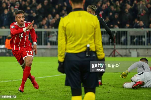 Corentin Tolisso of Bayern Muenchen celebrates after scoring a goal and Goalkeeper Alphonse Areola of Paris SaintGermain on the ground during the...