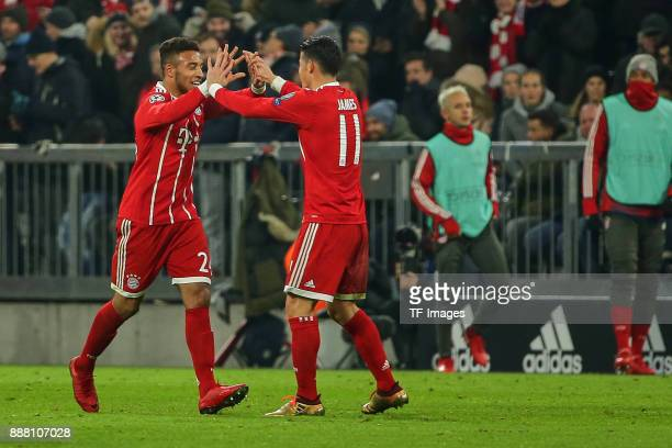 Corentin Tolisso of Bayern Muenchen celebrates with James Rodriguez of Bayern Muenchen after scoring a goal during the UEFA Champions League group B...
