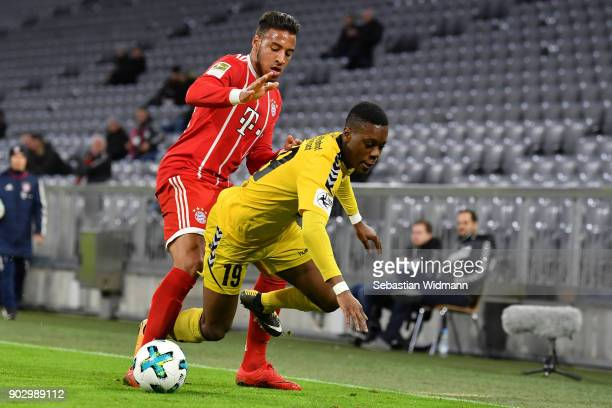 Corentin Tolisso of Bayern Muenchen challenges Makana Baku of Sonnenhof Grossaspach for the ball during the friendly match between Bayern Muenchen...