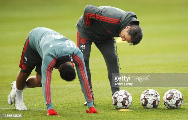 Corentin Tolisso of Bayern Muenchen chats to head coach Nico Kovac during Bayern Muenchen training at Saebener Strasse training ground on March 19,...