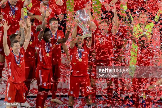 Corentin Tolisso of Bayern Muenchen cheers after winning the Supercup after the UEFA Super Cup match between FC Bayern Munich and FC Sevilla at...