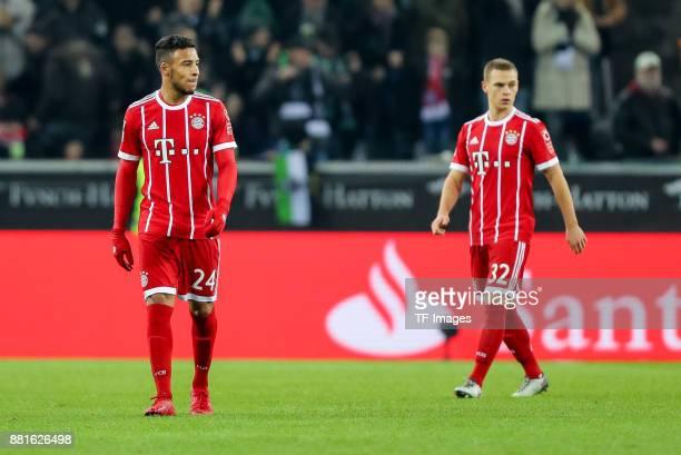 Corentin Tolisso of Bayern Muenchen Joshua Kimmich of Bayern Muenchen looks dejected during the Bundesliga match between Borussia Moenchengladbach...