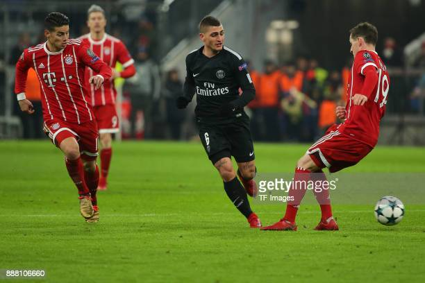 Corentin Tolisso of Bayern Muenchen Marco Verratti of Paris SaintGermain and Sebastian Rudy of Bayern Muenchen battle for the ball during the UEFA...