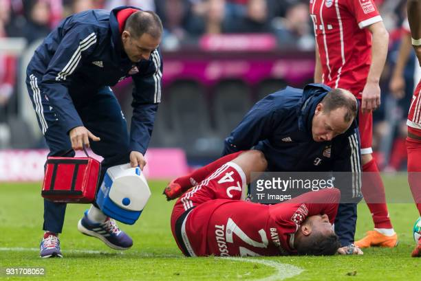 Corentin Tolisso of Bayern Muenchen reacts after being injured during the Bundesliga match between FC Bayern Muenchen and Hamburger SV at Allianz...