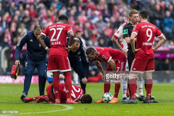 Corentin Tolisso of Bayern Muenchen reacts after being injured on the ground during the Bundesliga match between FC Bayern Muenchen and Hamburger SV...