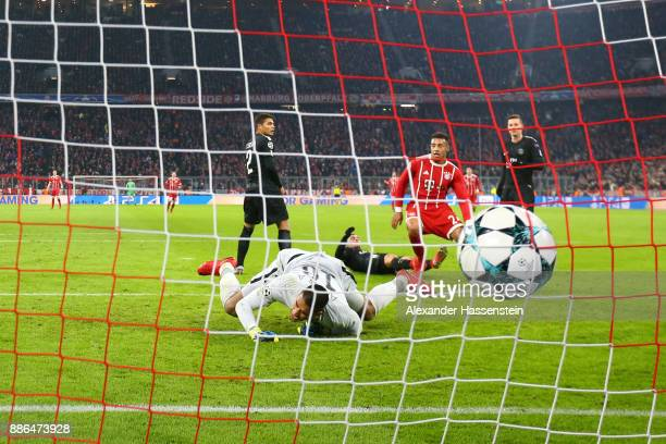 Corentin Tolisso of Bayern Muenchen scores his sides third goal past Alphonse Areola of PSG during the UEFA Champions League group B match between...