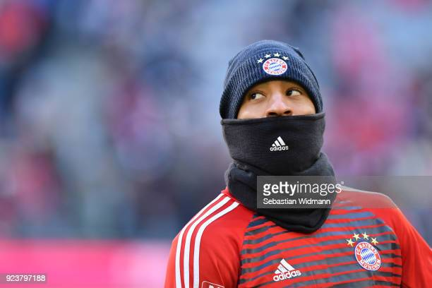 Corentin Tolisso of Bayern Muenchen with hat and high scarf to cover his face looks on before the Bundesliga match between FC Bayern Muenchen and...