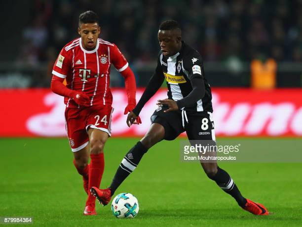Corentin Tolisso of Bayern Munich battles for the ball with Denis Zakaria of Borussia Monchengladbach during the Bundesliga match between Borussia...
