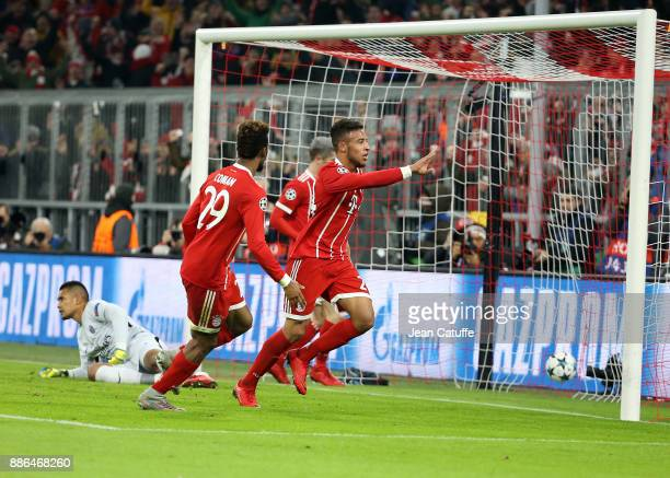 Corentin Tolisso of Bayern Munich celebrates his goal with Kingsley Coman while goalkeeper of PSG Alphonse Areola lies down during the UEFA Champions...