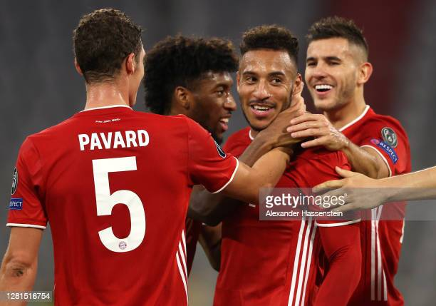 Corentin Tolisso of Bayern Munich celebrates with teammates after scoring his team's third goal during the UEFA Champions League Group A stage match...
