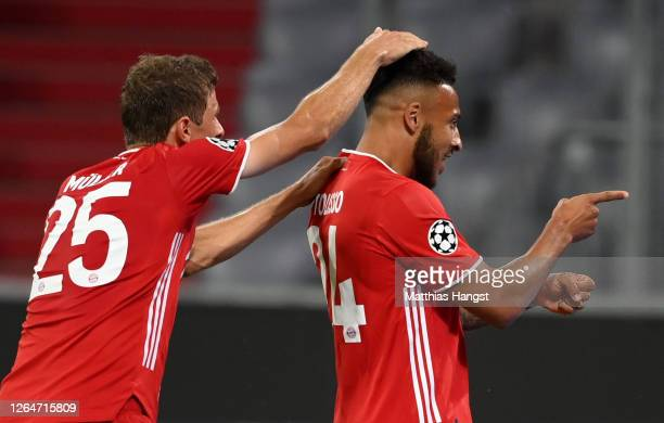 Corentin Tolisso of Bayern Munich celebrates with Thomas Mueller of Bayern Munich after scoring his sides third goal during the UEFA Champions League...