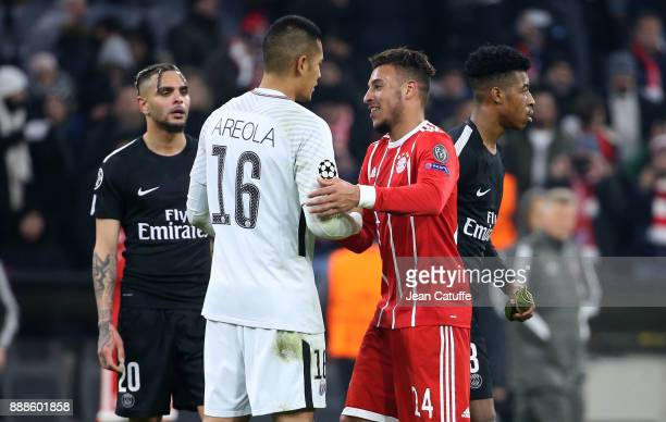Corentin Tolisso of Bayern Munich greets goalkeeper of PSG Alphonse Areola while Layvin Kursawa Presnel Kimpembe of PSG look on following the UEFA...