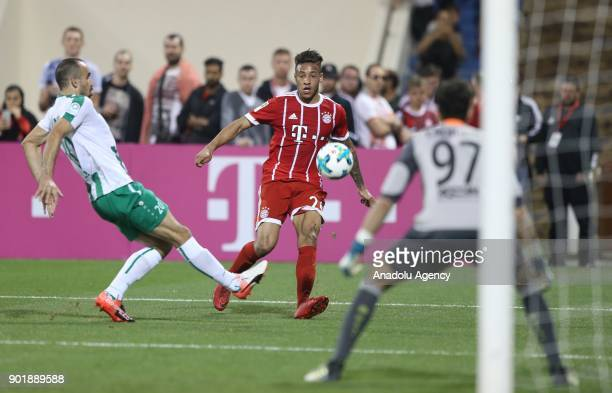 Corentin Tolisso of Bayern Munich in action against Hadi Al Masri of AlAhly during a friendly match between FC Bayern Munich and AlAhly at Aspire...