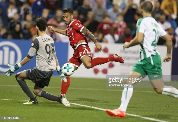 Corentin Tolisso of Bayern Munich in action against Y AlSheikh of AlAhly during a friendly match between FC Bayern Munich and AlAhly at Aspire...