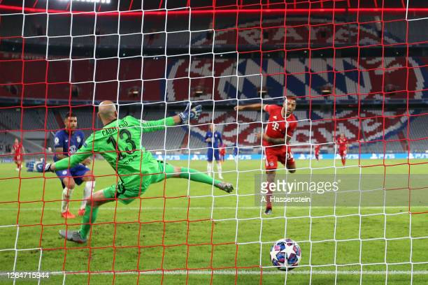 Corentin Tolisso of Bayern Munich scores his team's third goal against Willy Caballero of Chelsea during the UEFA Champions League round of 16 second...