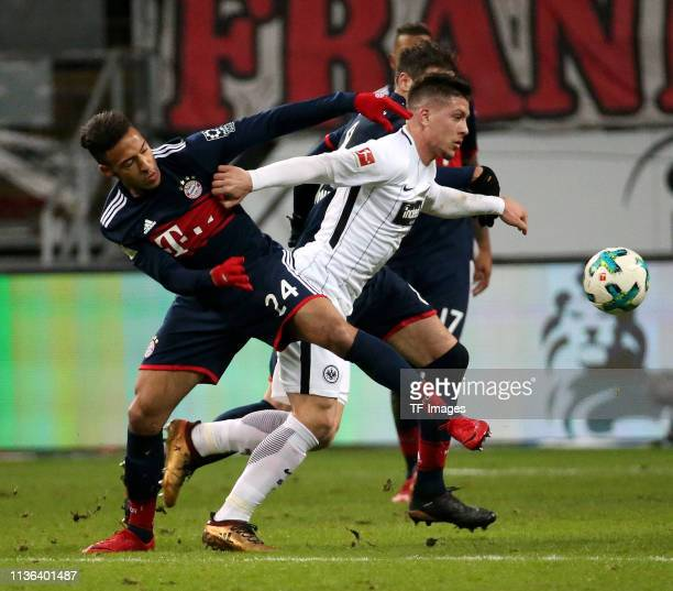 Corentin Tolisso of Eintracht Frankfurt Luka Jovic of FC Bayern Muenchen and Javi Martinez of FC Bayern Muenchen battle for the ball during the...