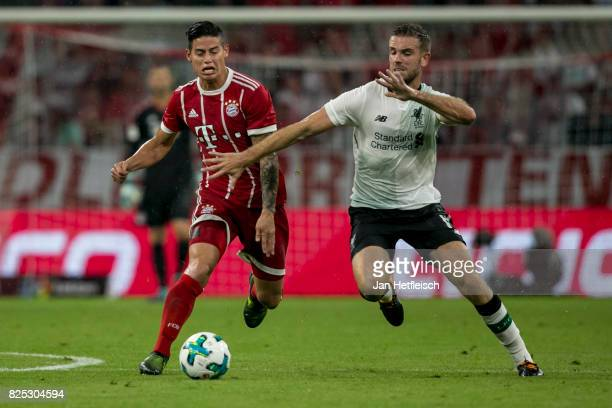 Corentin Tolisso of FC Bayern Muenchen and a player on Liverpool fight for the ball during the Audi Cup 2017 match between Bayern Muenchen and...