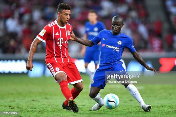 Corentin Tolisso of FC Bayern Muenchen and N'Golo Kante of Chelsea FC competes for the ball during the International Champions Cup match between...