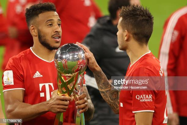 Corentin Tolisso of FC Bayern Muenchen celebrates with his team mate Lucas Hernandez after the Supercup 2020 match between FC Bayern München and...