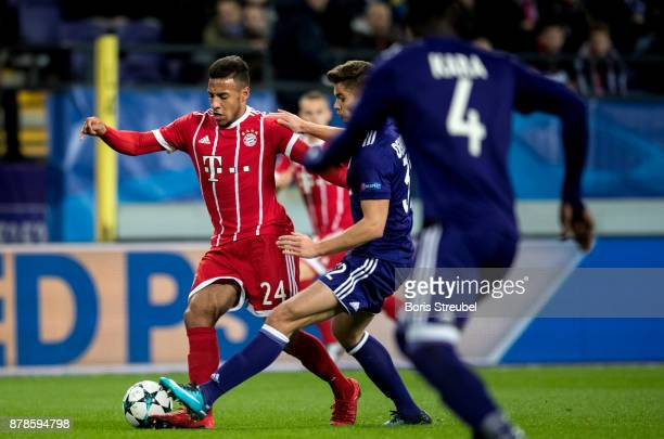 Corentin Tolisso of FC Bayern Muenchen is challenged by Leander Dendoncker of Anderlecht during the UEFA Champions League group B match between RSC...