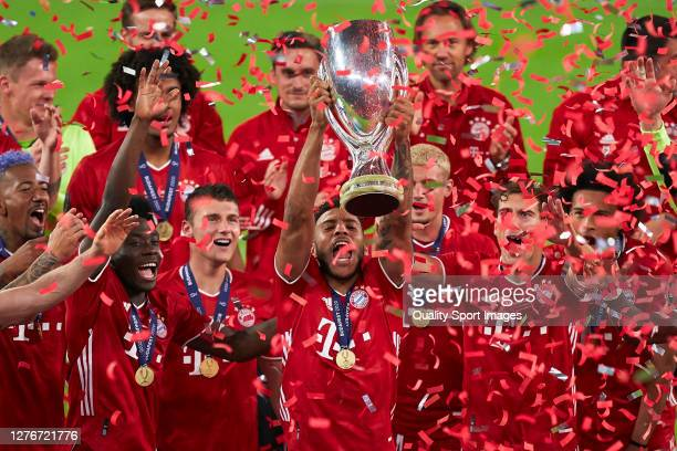 Corentin Tolisso of FC Bayern Munich lifts the UEFA Super Cup trophy as he and team mates celebrate victory after the UEFA Super Cup match between FC...