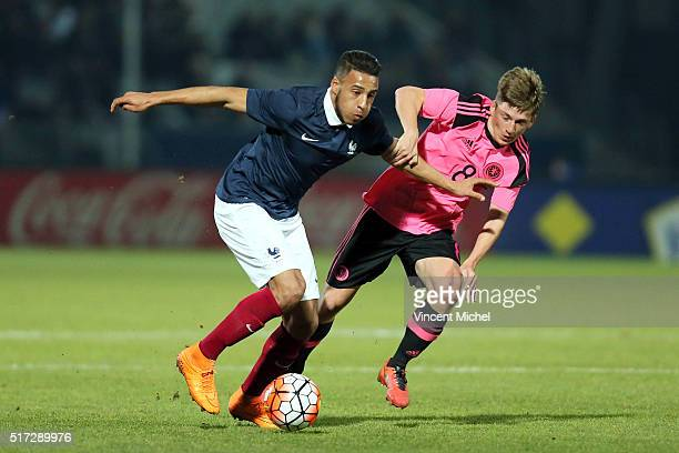 Corentin Tolisso of France and Ryan Gauld of Scotland during the Uefa U21 European Championship qualifier between France and Scotland at Stade Jean...