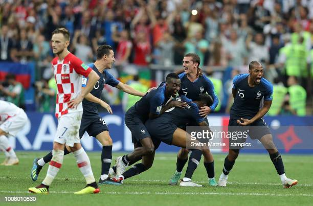 Corentin Tolisso of France Florian Thauvin of France Antoine Griezmann of France celebrate following their sides victory Ivan Rakitic of Croatia in...