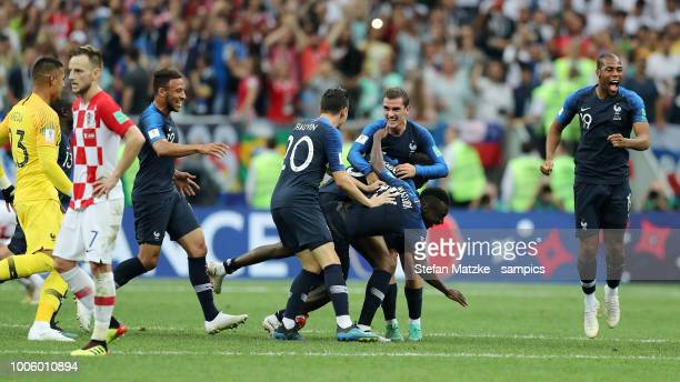 Corentin Tolisso of France Florian Thauvin of France Antoine Griezmann of France celebrate following their sides victory Ivan Rakitic of Croatiain...
