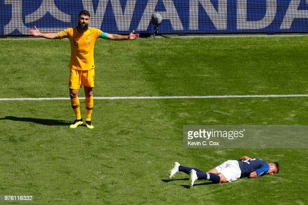 Corentin Tolisso of France goes down and Mile Jedinak of Australia reacts during the 2018 FIFA World Cup Russia group C match between France and...