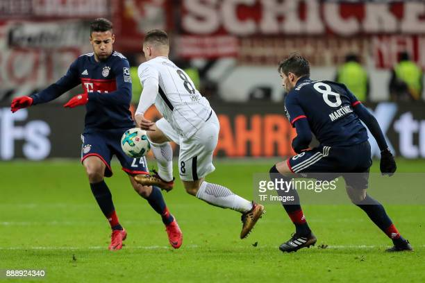 Corentin Tolisso of Muenchen and Luka Jovic of Frankfurt battle for the ball during the Bundesliga match between Eintracht Frankfurt and FC Bayern...