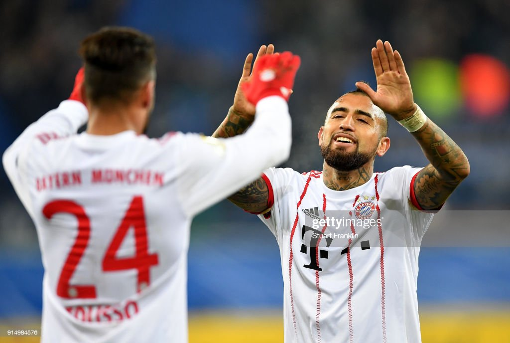 Corentin Tolisso #24 of Muenchen celebrate victory with team mate Arturo Vidal after the DFB Cup quarter final match between SC Paderborn and Bayern Muenchen at Benteler Arena on February 6, 2018 in Paderborn, Germany.